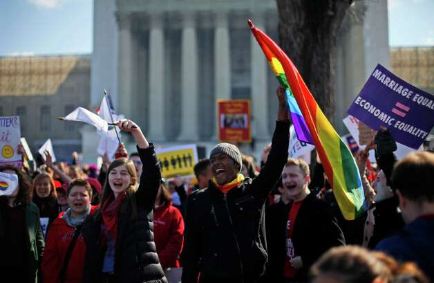 Demonstrators chant outside the Supreme Court in Washington, Tuesday, March 26, 2013, as the court heard arguments on California's voter approved ban on same-sex marriage, Proposition 8. Photo: Pablo Martinez Monsivais