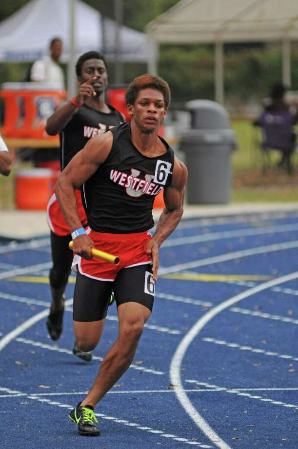 Westfield sophomore 400-meter relay anchor Latevius Downs (right) heads for home after taking a handoff from senior Chantz Singletary (in background) at the Victor Lopez Relays earlier this month. Photo: L. Scott Hainline / Freelance
