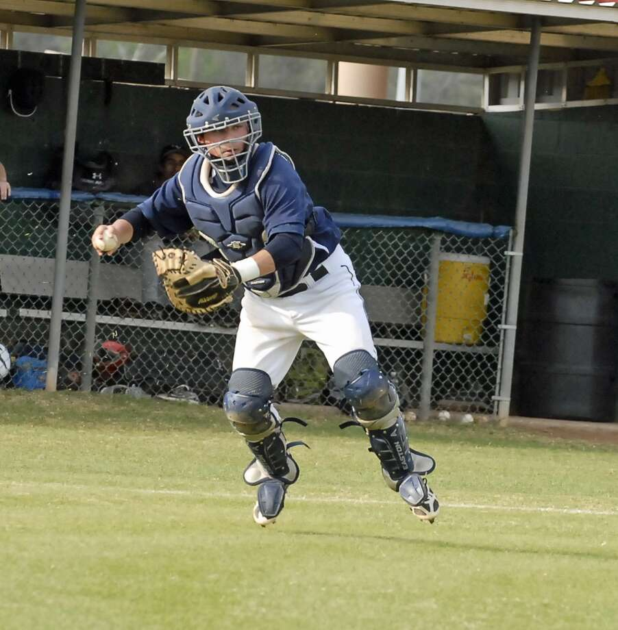 Lamar catcher Harry Wadley fielded a bunt before completing the throw to first for an out during the Redskins' 15-0 win over Carnegie Vanguard last week. Photo:  Tony Bullard 2013, Freelance Photographer / © Tony Bullard & the Houston Chronicle