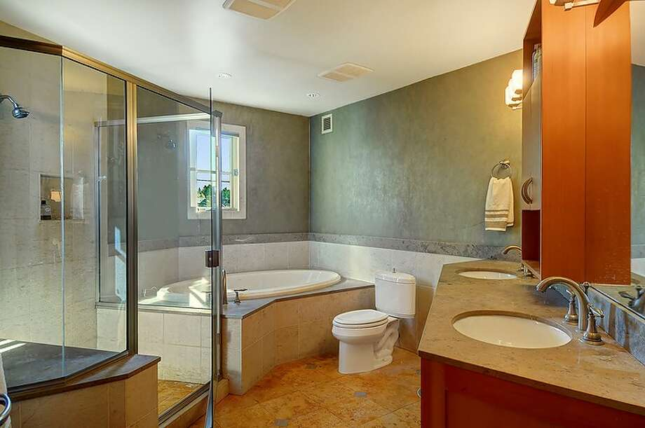 Bathroom of 2508 57th Ave. S.W. The 2,386-square-foot Mediterranean-style home, built in 2002, has three bedrooms and 3.25 bathrooms -- including a mother-in-law apartment -- limestone floors, iron railings and a balcony on a 1,575-square-foot lot. It's listed for $699,950. Photo: Courtesy Sandra Hines/Windermere Real Estate