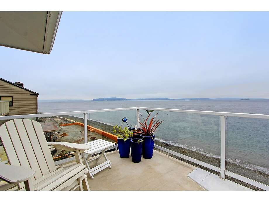 Deck of 3121 Alki Ave. S.W., Unit A. The 1,397-square-foot home, built in 1977, has two bedrooms, 1.75 bathrooms, big windows, a sauna, and sound and city views. It's listed for $685,000. Photo: Courtesy Randie Stone/Windermere Real Estate
