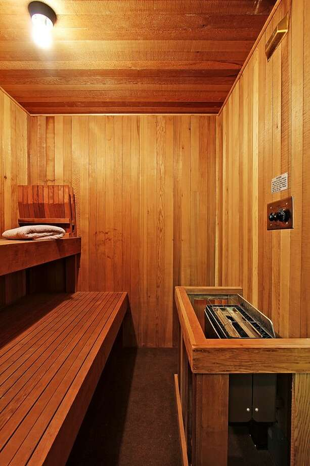 Sauna of 3121 Alki Ave. S.W., Unit A. The 1,397-square-foot home, built in 1977, has two bedrooms, 1.75 bathrooms, big windows, a long deck, and sound and city views. It's listed for $685,000. Photo: Courtesy Randie Stone/Windermere Real Estate