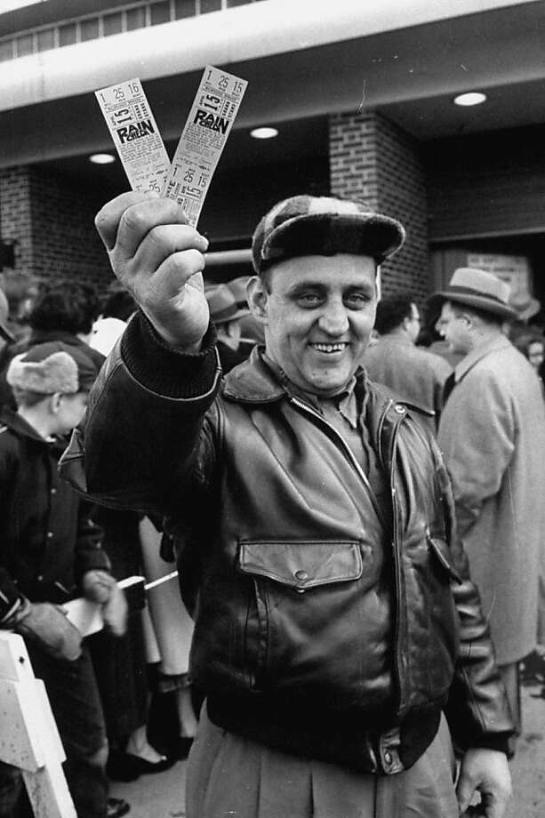 A happy baseball fan with advance tickets for Opening Day 1954 in Milwaukee. Photo: Francis Miller, Time Life Pictures/Getty Images