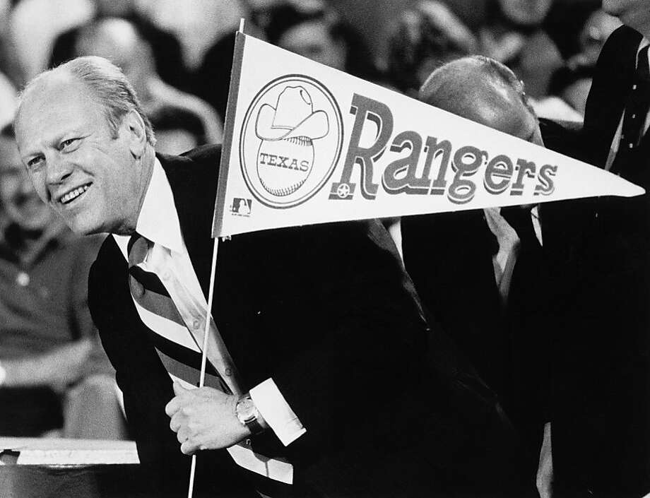 President Gerald Ford holds a Rangers flag after throwing out the first pitch at the opening game for the 1976 Texas Rangers on April 9, 1976 at Arlington Stadium. Photo: MLB Photos, Getty Images