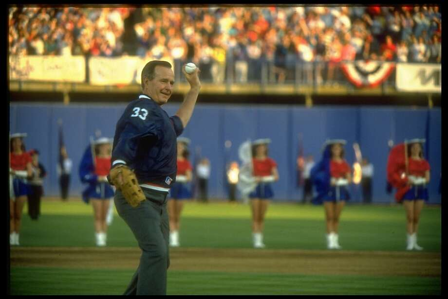 President George Bush indulges in high jinks before throwing out the opening pitch at Rangers baseball game in 1991. Photo: Dirck Halstead, Time Life Pictures/Getty Images