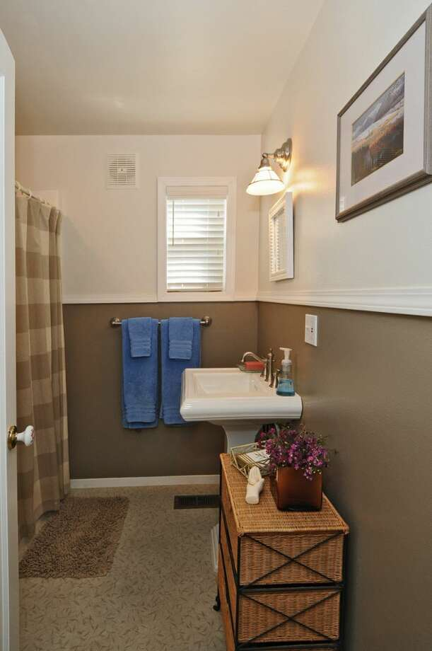 Bathroom of 3432 62nd Ave S.W. The 2,830-square-foot house, built in 1947, has three bedrooms, three bathrooms, a family room with lofted ceilings, a patio, a deck and a two-car garage on a 4,800-square-foot lot. It's listed for $695,000. Photo: Courtesy James Tibbetts And Tamera Duke /Windermere Real Estate