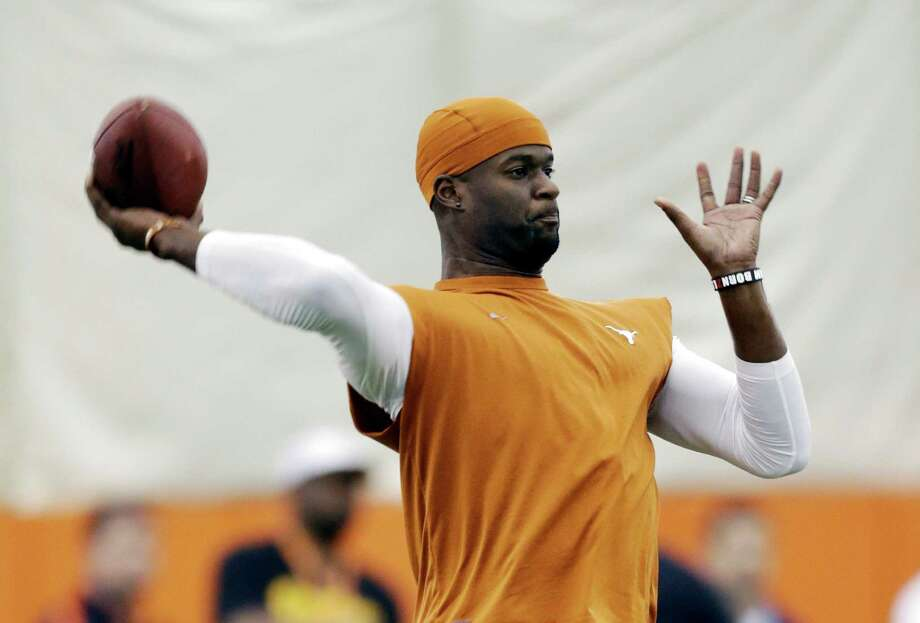 Read about Vince Young's comeback attempt here.Former Texas quarterback Vince Young throws for scouts at Texas' NFL football pro day, Tuesday, March 26, 2013, in Austin, Texas. Young, who was cut by the Buffalo Bills in the 2012 preseason, is attempting a comeback. Photo: Eric Gay, Associated Press / AP