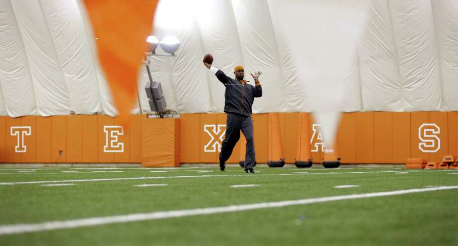 Texas alum and former NFL quarterback Vince Young warms up prior to throwing for scouts at Texas' NFL football pro day, Tuesday, March 26, 2013, in Austin, Texas. Young, who was cut by the Buffalo Bills in the 2012 preseason, is attempting a comeback. (AP Photo/Eric Gay) Photo: Eric Gay, Associated Press / AP