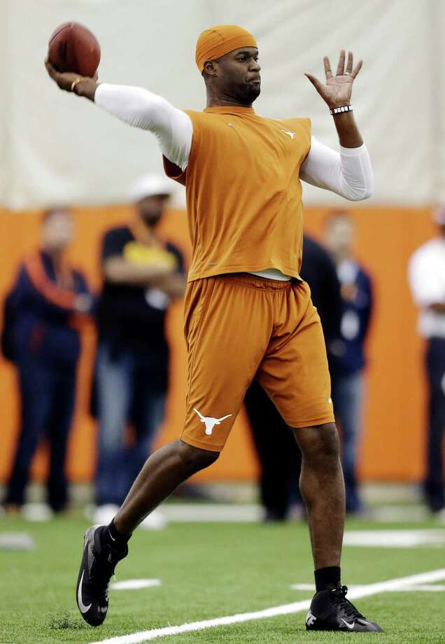 Former University of Texas and NFL quarterback Vince Young throws for scouts at Texas' football pro day, Tuesday, March 26, 2013, in Austin, Texas. (AP Photo/Eric Gay) Photo: Eric Gay, Associated Press / AP