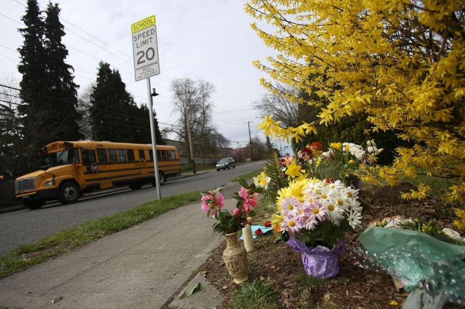 Flowers are shown at a growing memorial at 33rd Avenue NE and NE 75th Street on Tuesday, March 26, 2013 in Seattle. Two people were killed when hit by a truck the day before. A mother and her ten day-old infant were also critically injured when the truck struck the family. The driver was arrested for suspicion of DUI. (Joshua Trujillo, seattlepi.com)