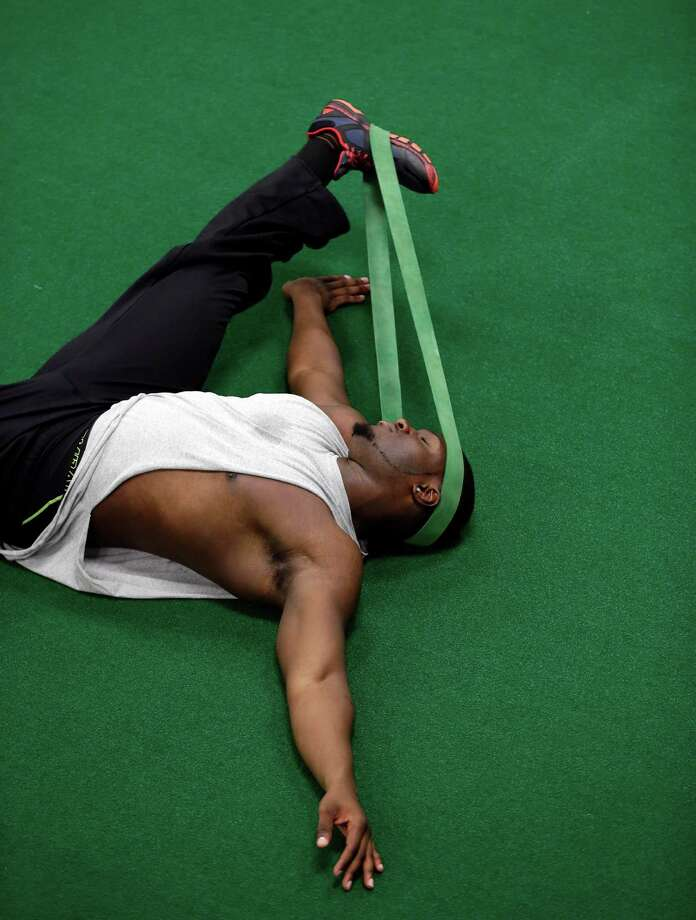 Ryan Roberson stretches before working out for scouts at Texas' NFL football pro day, Tuesday, March 26, 2013, in Austin, Texas. (AP Photo/Eric Gay) Photo: Eric Gay, Associated Press / AP