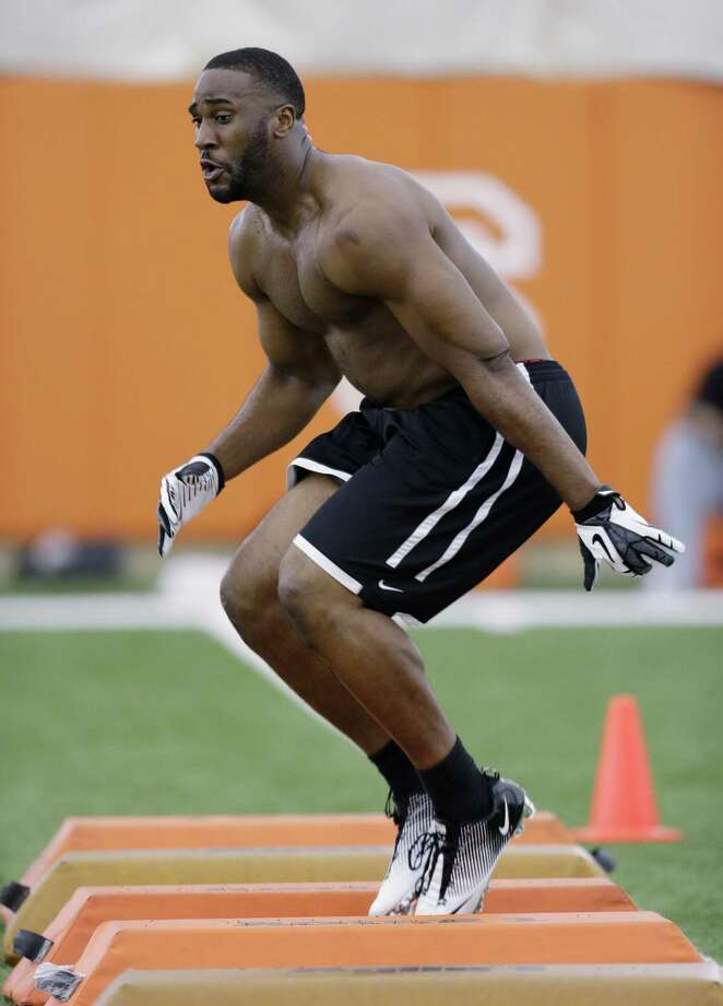 Defensive end Alex Okafor goes through drills for scouts at Texas' NFL football pro day at the university's facility, Tuesday, March 26, 2013, in Austin, Texas. (AP Photo/Eric Gay) Photo: Eric Gay, Associated Press / AP