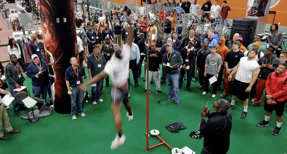 Ryan Roberson measures his high jump as NFL scouts watch at Texas' NFL football pro day, Tuesday, March 26, 2013, in Austin, Texas. (AP Photo/Eric Gay) Photo: Eric Gay, Associated Press / AP