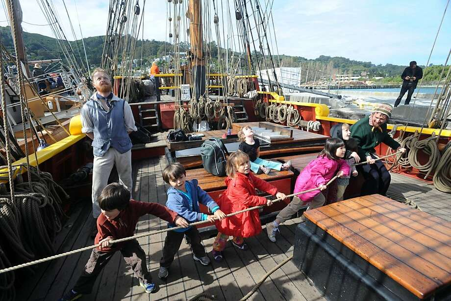 Caleb Stripes (right) helps children including (from left) Jacob and Eli Schiffman, Sonett Butterfield and Kaylia Roark Hernandez set a sail on the tall ship Lady Washington that is docked near the Bay Model Visitors Center in Sausalito on March 26, 2013. The ship, along with the Hawaiian Cheiftain, will be here until April 2, 2013. Photo: Susana Bates, Special To The Chronicle