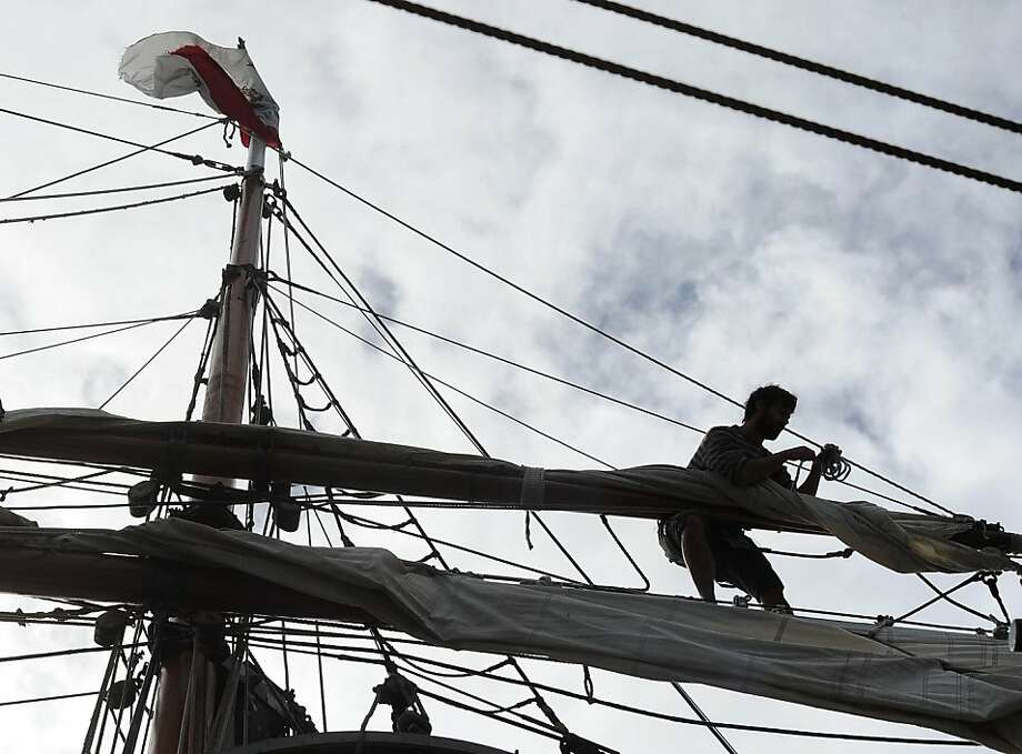 Pelayo Secades unfurls a sail on the tall ship Hawaiian Chieftain before it set out for a three hour educational class in Sausalito on March 26, 2013. The ship, along with the Lady Washington will be here until April 2, 2013. Photo: Susana Bates, Special To The Chronicle
