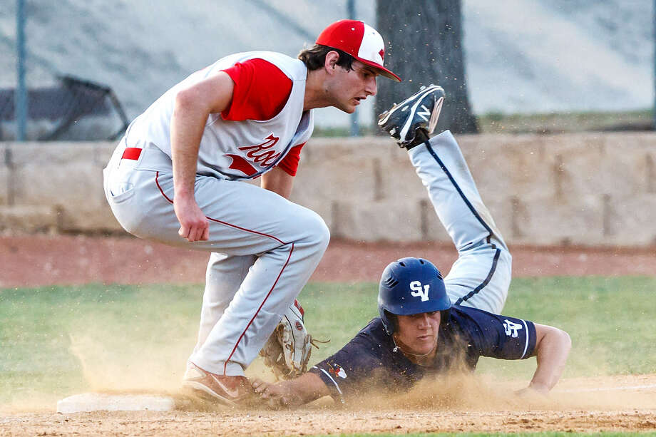 Judson's Mike Serry tags out Smithson Valley's Joey Bochat at third base to end the first inning of their game Friday at Smithson Valley. Photo: Marvin Pfeiffer / NE Herald