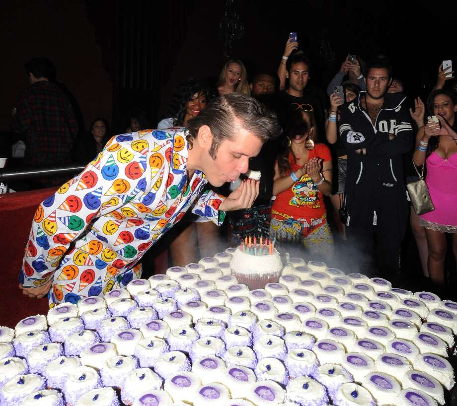 In this photo provided by Perez Hilton, Hilton blows out candles at his Pajama Birthday Party at the El Rey Theatre, Saturday, March 23, 2013, in Los Angeles. (Photo by WINNK for Perez Hilton) Photo: Katy Winn, Associated Press / WINNK for Perez Hilton