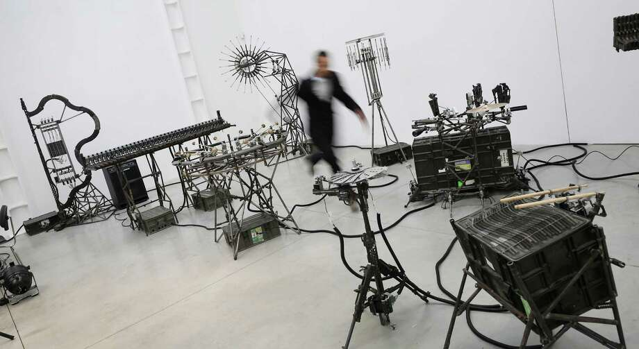 "The nine mechanical musical instruments in ""Imagine"" can be automated or played live by an individual operator using a laptop computer or midi keyboard.  Photo: Peter Macdiarmid, Getty Images / 2013 Getty Images"
