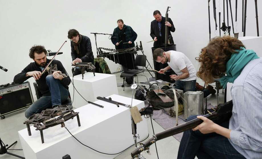 Musicians play instruments made from recycled gun parts  at the Lisson Gallery on March 26, 2013 in London. Photo: Peter Macdiarmid, Getty Images / 2013 Getty Images