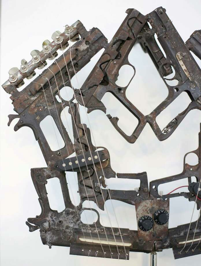 An instrument made from recycled gun parts and a soldier's helmet is shown at the Lisson Gallery on March 26, 2013 in London. Photo: Peter Macdiarmid, Getty Images / 2013 Getty Images