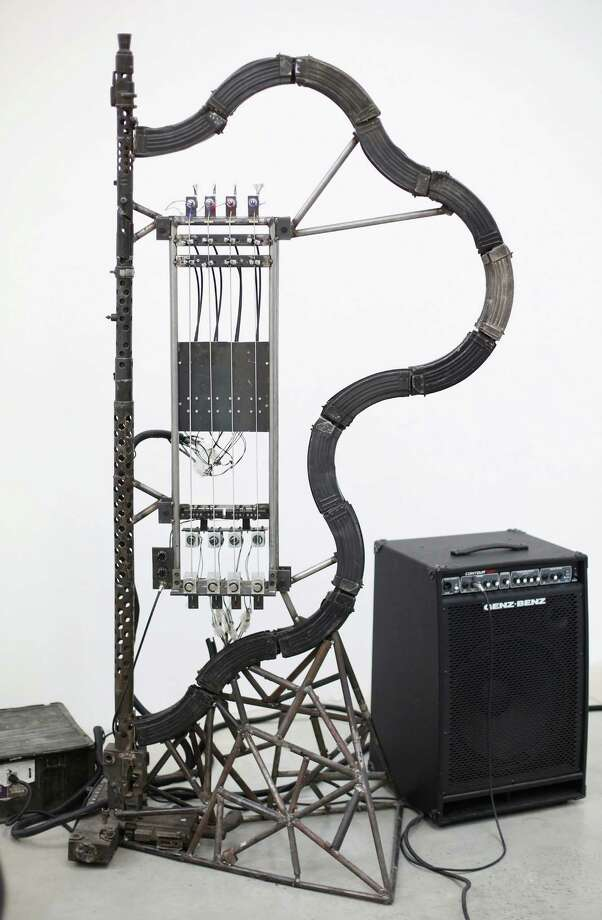 A mechanical musical instrument made from recycled gun parts is shown at