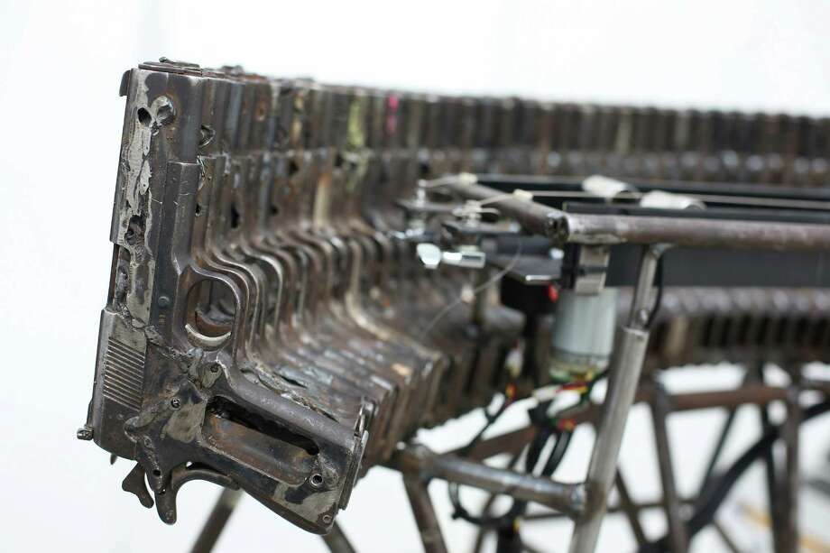 A musical instrument made from recycled gun parts is shown at