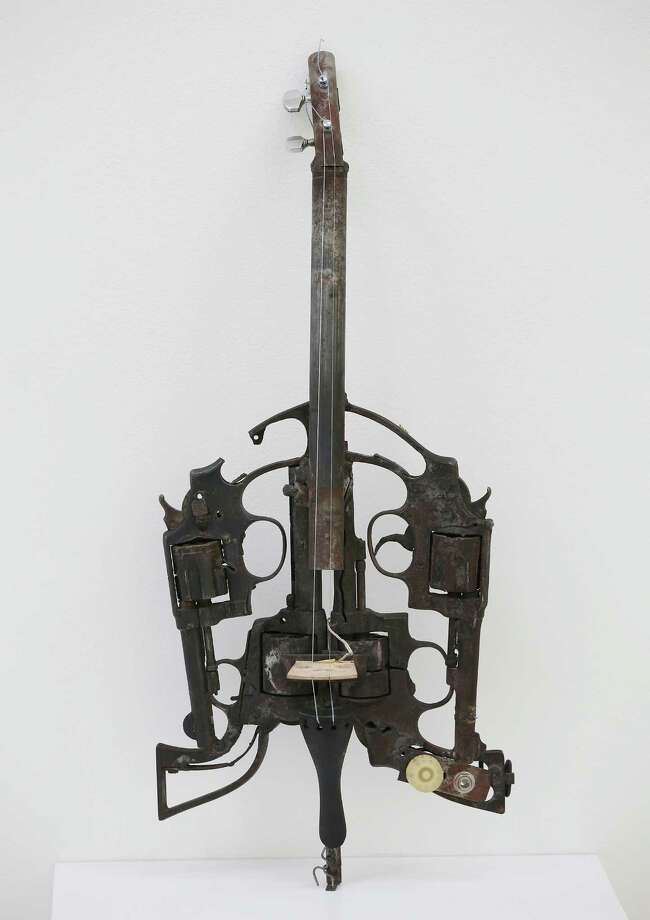 A guitar made from recycled gun parts and a soldier's helmet is shown at the Lisson Gallery on March 26, 2013 in London. Photo: Peter Macdiarmid, Getty Images / 2013 Getty Images