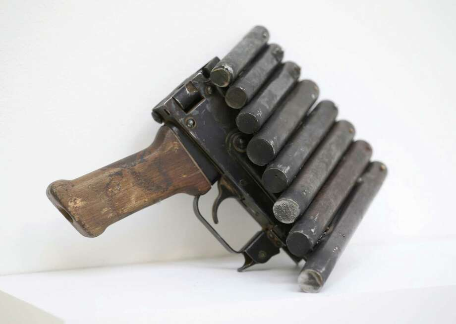 Pan pipes made from recycled gun parts and a soldier's helmet is shown at the Lisson Gallery on March 26, 2013 in London. Photo: Peter Macdiarmid, Getty Images / 2013 Getty Images