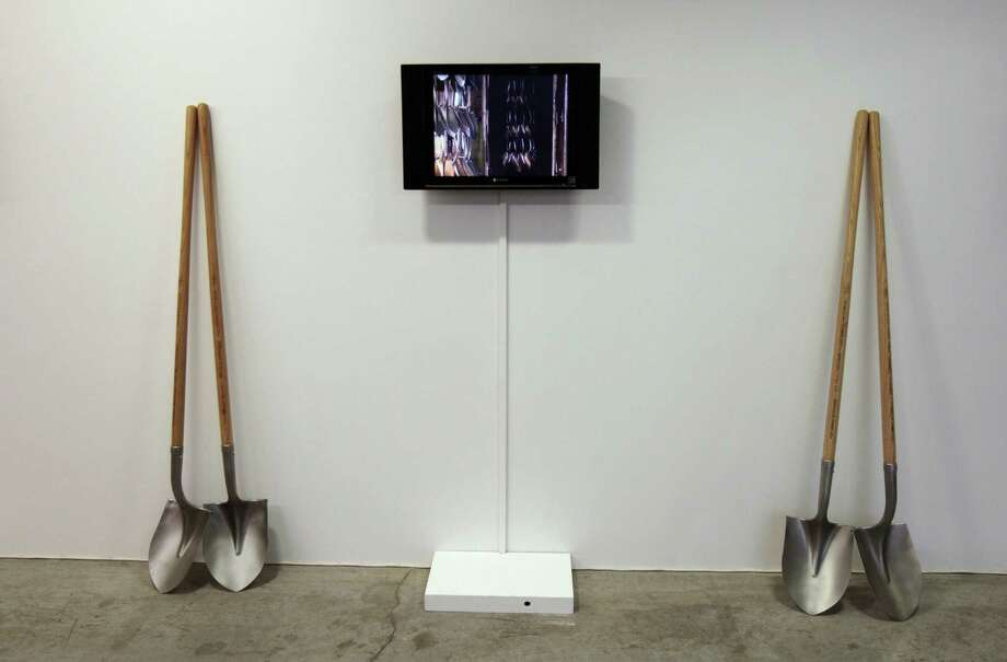 The shovels, shown here in Paris' Maison Rouge art gallery, were used to plant 1,527 trees around the world. Photo: FRANCOIS GUILLOT, AFP/Getty Images / 2008 AFP