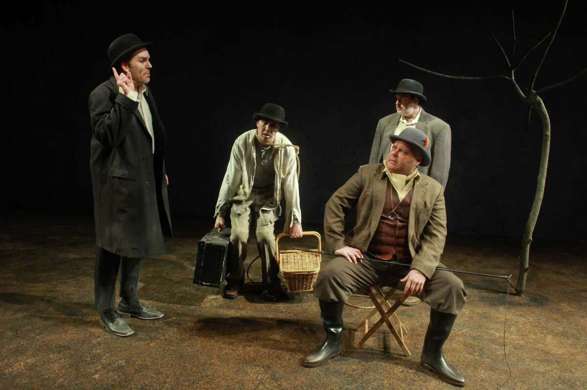 """(For the Chronicle/Gary Fountain, March 13, 2013) Greg Dean as Valdimir, from left, Troy Schulze as Lucky, Charlie Scott as Estragon and Kyle Sturdivant (seated), as Pozzo, in this scene from Catastrophic Theatre's """"Waiting for Godot."""""""