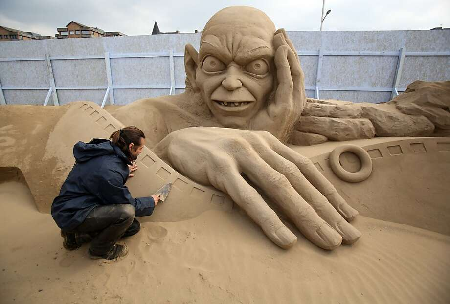 WESTON-SUPER-MARE, ENGLAND - MARCH 26:  Sand sculptor Radavan Zivny works on a sand sculpture of Gollum as pieces are prepared as part of this year's Hollywood themed annual Weston-super-Mare Sand Sculpture festival on March 26, 2013 in Weston-Super-Mare, England. Due to open on Good Friday, currently twenty award winning sand sculptors from across the globe are working to create sand sculptures including Harry Potter, Marilyn Monroe and characters from the Star Wars films as part of the town's very own movie themed festival on the beach.  (Photo by Matt Cardy/Getty Images) Photo: Matt Cardy, Getty Images