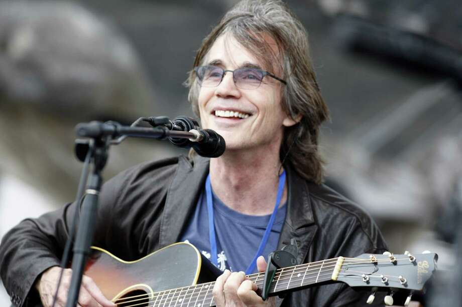 FILE - This July 29, 2012 file photo shows Jackson Browne performing at the Newport Folk Festival in Newport, R.I. Browne will perform at the Rock and Roll Hall of Fame induction ceremony on April 18 in Los Angeles. (AP Photo/Joe Giblin, file) Photo: Joe Giblin