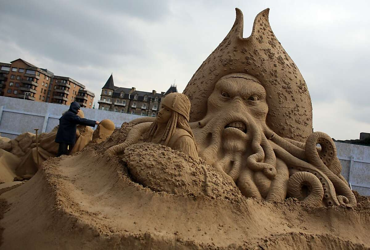 """The tentacled mug of """"Pirates of the Caribbean's"""" Capt. Davy Jones glares malevolently in this year's Hollywood-themed Sand Sculpture Festival in Weston-super-Mare, England. Twenty award-winning sand sculptors are finishing famous film figures for the festival, due to open on Good Friday. Check out their creations!"""