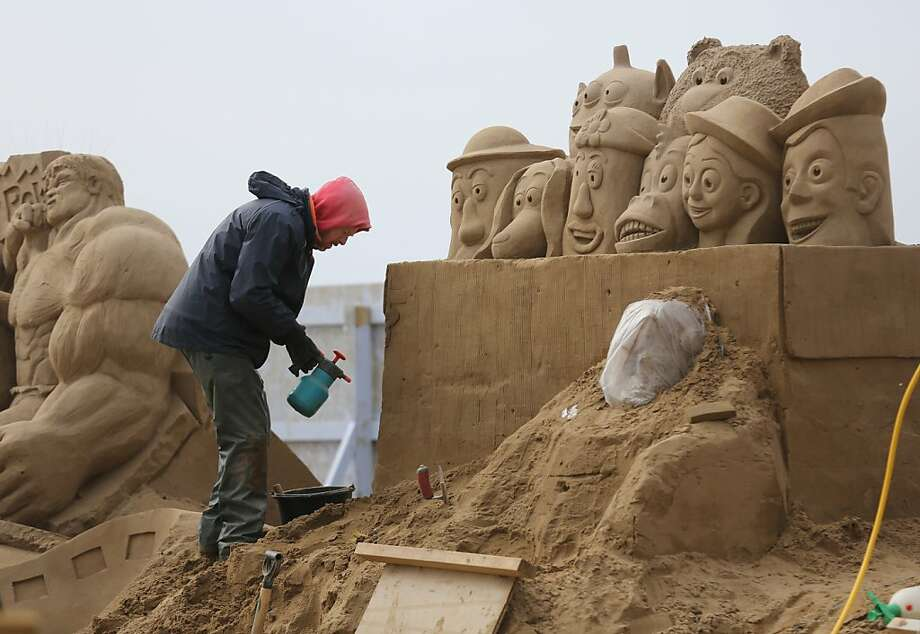 "Toys peer out of box in a ""Toy Story""-themed entry at the Weston-super-Mare Sand Sculpture Festival. Photo: Matt Cardy, Getty Images"