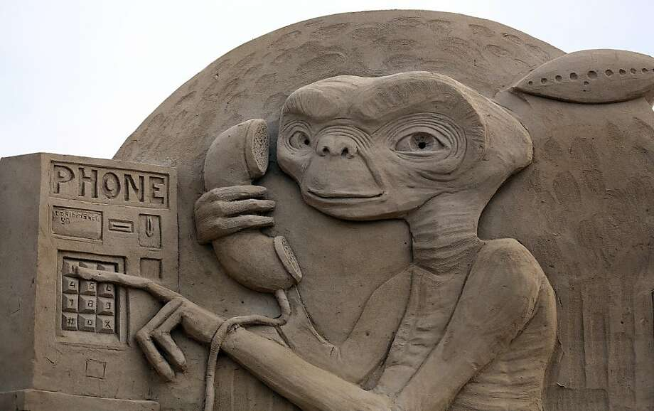 "E.T. phones home on a ""pay telephone,"" a public communication device popular in the last century. Photo: Matt Cardy, Getty Images"