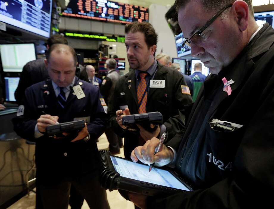 Traders work on the floor of the New York Stock Exchange Tuesday, March 19, 2013. European markets steadied Tuesday March 26, 2013, a day after they were roiled by a suggestion from a leading European finance official that the Cyprus bailout was a model for the future. (AP Photo/Richard Drew) Photo: Richard Drew