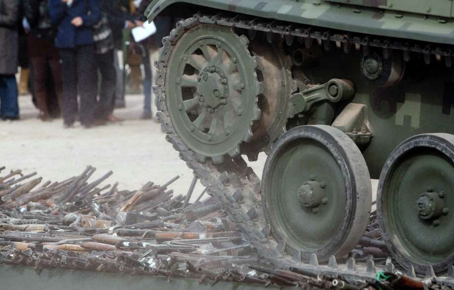 A tank rolls over thousands of guns are destroyed in Ciudad Juarez, Mexico on February 16, 2012. Photo: JESUS ALCAZAR, AFP/Getty Images / 2012 AFP