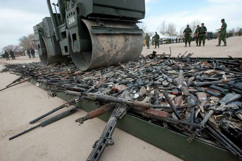 A steamroller rolls over thousands of guns are destroyed in Ciudad Juarez, Mexico on February 16, 2012. Photo: JESUS ALCAZAR, AFP/Getty Images / 2012 AFP