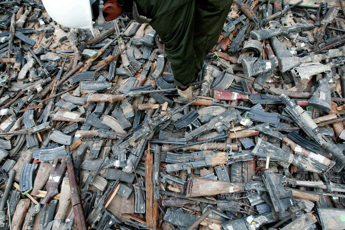 Thousands of guns lie on the ground before their destruction in Ciudad Juarez, Mexico on February 16, 2012.