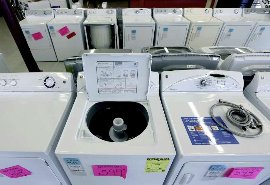 In this  Tuesday, Feb. 26, 2013, photo, washing machines are for sale at Green's, a furniture and appliance store, in Albany, N.Y. U.S. orders for long-lasting goods that signal business investment plans fell in February by the largest amount in seven months, although the decline followed a strong month in January and may prove to be a temporary setback. (AP Photo/Mike Groll) Photo: Mike Groll