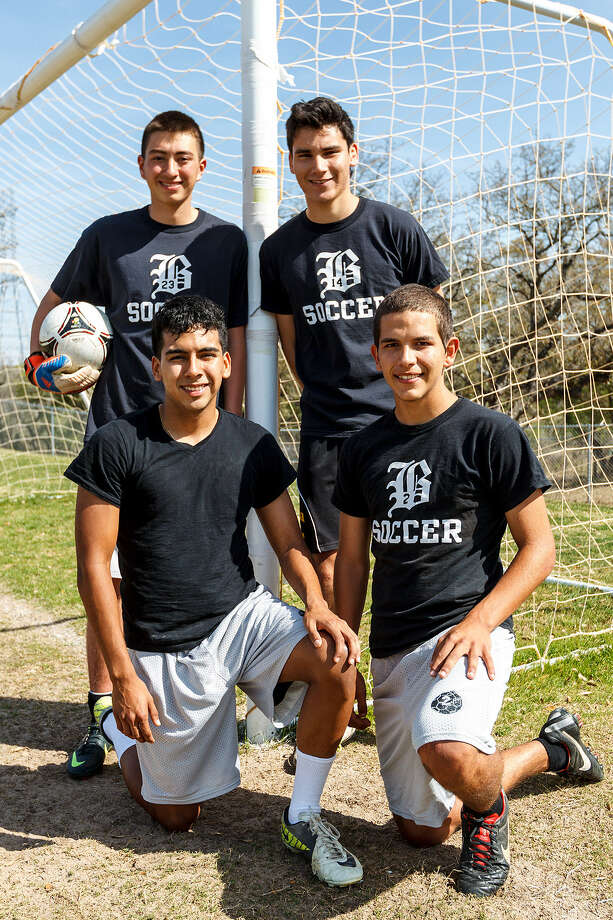 Brennan boys soccer players Josh Lowe (clockwise from upper left), Alan Aguiar, Byron Fernandez and Carlos Garcia prior to a practice session at the school. Photo: Marvin Pfeiffer / Northwest Weekly