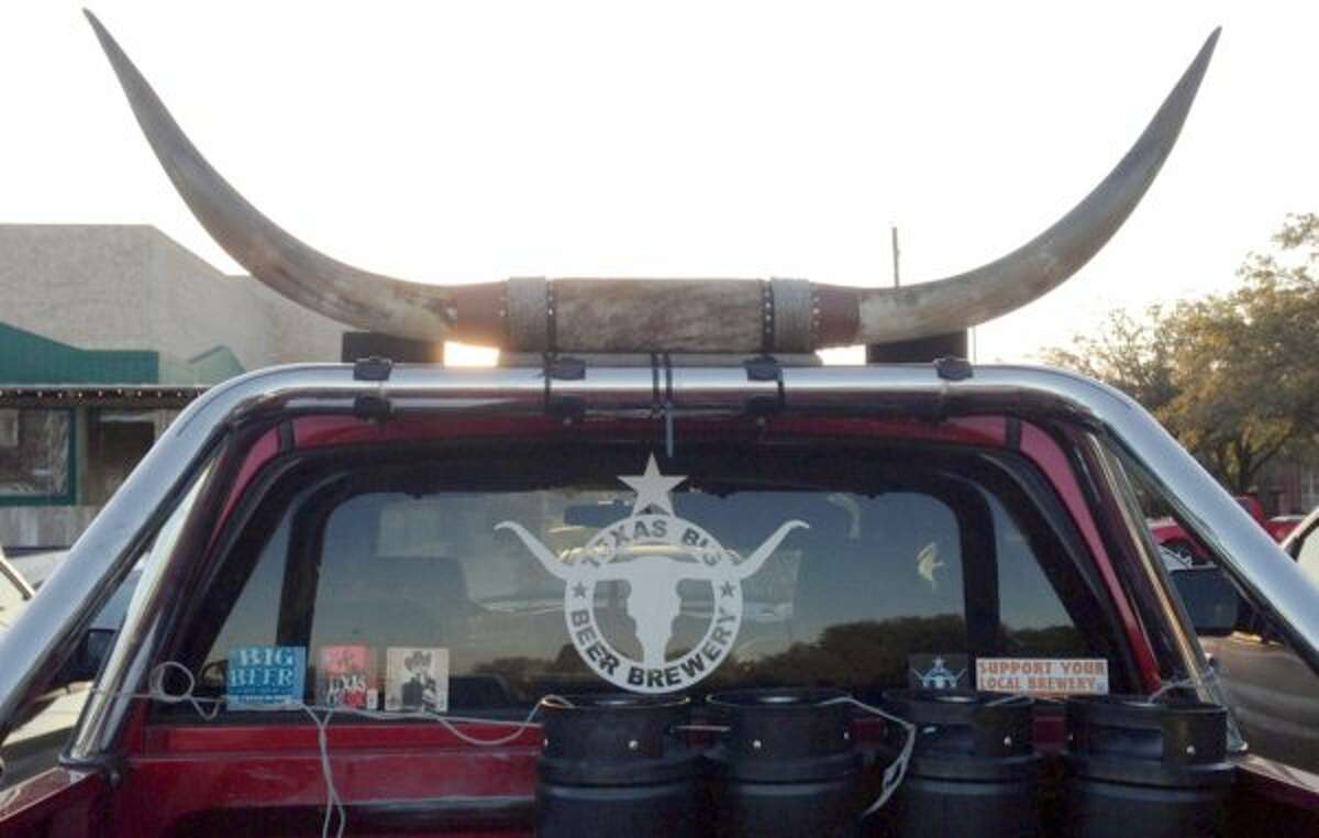 John and Tammy McKissack deliver beer from their Texas Big Beer Brewery in southeast Texas in this pickup.