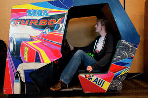 Arthur Haugh plays Sega's Turbo at the 27th annual Game Developers Conference, held at the Moscone Center in San Francisco, in the vintage game exhibits featuring playable versions of early games on March 26th 2013.