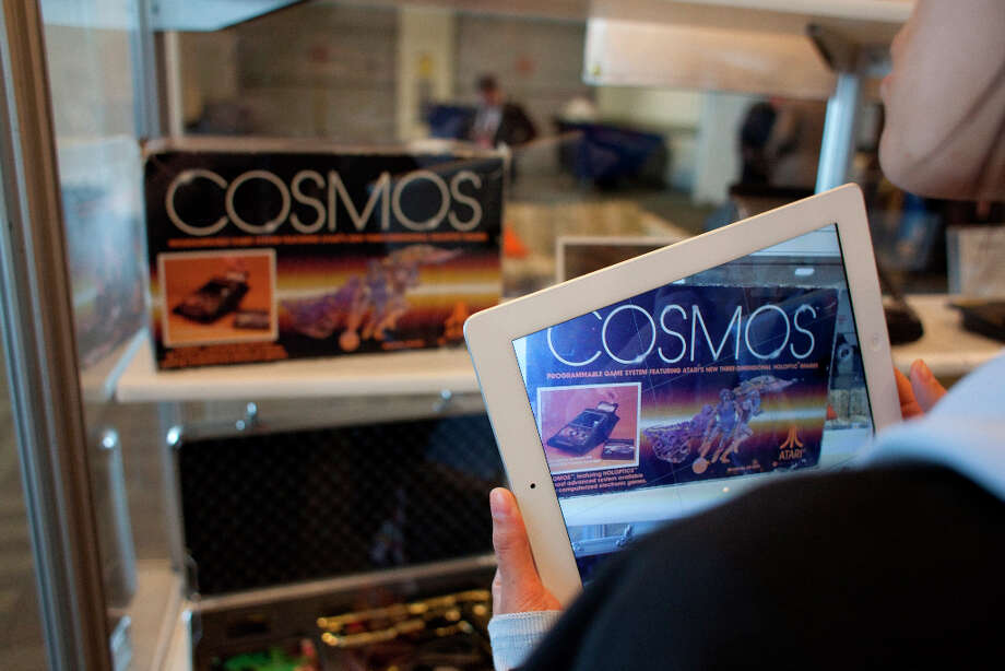 Mica Wong take a picture of the Cosmos on her Ipad at the 27th annual Game Developers Conference, held at the Moscone Center in San Francisco, in the vintage game exhibits featuring playable versions of early games on March 26th 2013. Photo: Sam Wolson, SFC / ONLINE_YES
