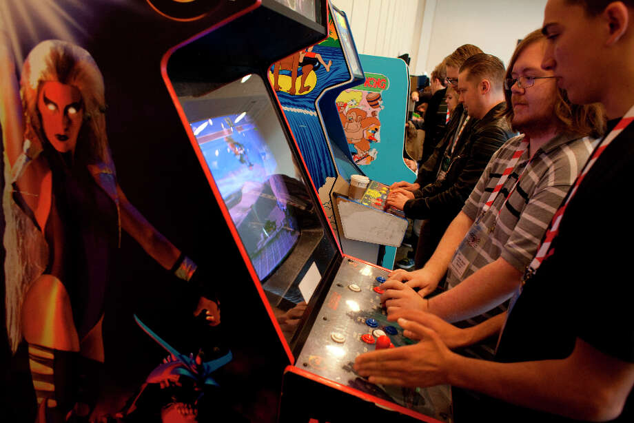 Jordan Barret and Bruno De leone play Ultimate Mortal Combat 3 at the 27th annual Game Developers Conference, held at the Moscone Center in San Francisco, in the vintage game exhibits featuring playable versions of early games on March 26th 2013. Photo: Sam Wolson, SFC / ONLINE_YES