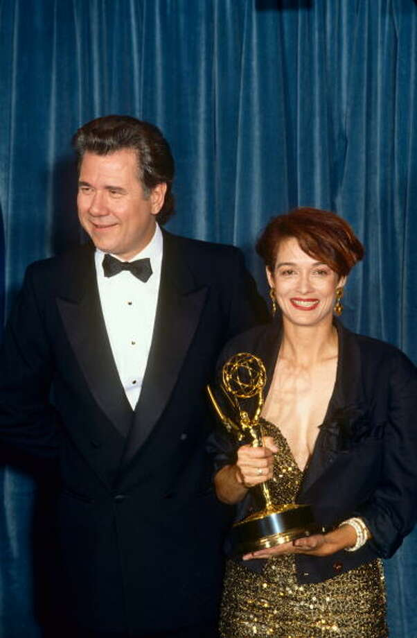 Melanie Mayron is joined by presenter John Larroquette after winning an Emmy Award for her role in TV's thirtysomething at the 1989. Photo: George Rose, Getty Images / 1989 George Rose