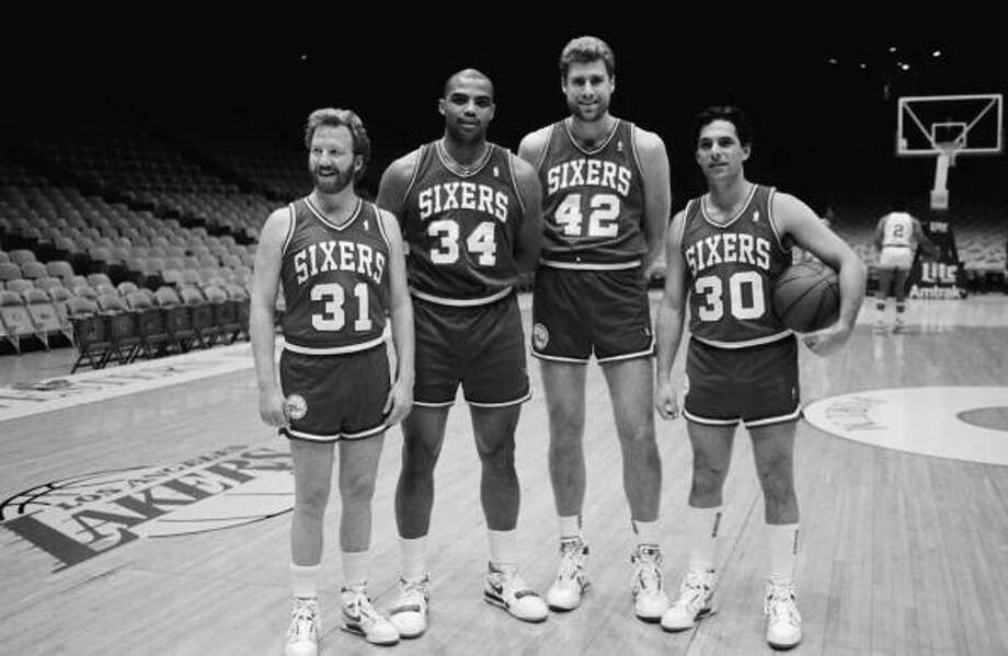 Ken Olin (right) and Timothy Busfield (left) of the hit TV show thirtysomething, act out a fantasy scene of playing for the Philadelphia 76ers basketball team with real players Charles Barkley and Mike Giminsky during a 1988 Los Angeles, California, taping at the Sports Arena. Photo: George Rose, Getty Images / 1987 George Rose