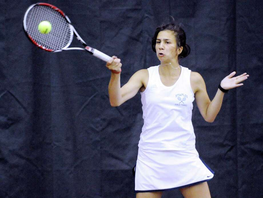 Melissa Beretta of Staples High School hits in match against Jen DeLuca of Greenwich High School in the girls high school Class L tennis playoff between Greenwich High School and Staples High School at Sound Shore Indoor Tennis, Port Chester, N.Y., Wednesday afternoon, June 1, 2011. Photo: Bob Luckey, ST / Greenwich Time