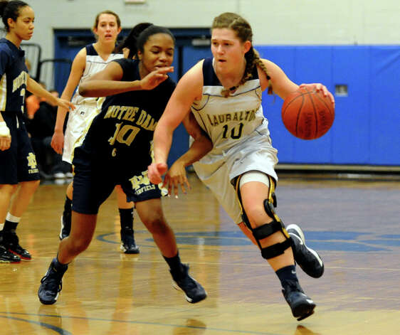 Lauralton Hall's #10 Carly Fabbri drives past Notre Dame of Fairfield defender #10 Jerlisa Thomas, during SWC girls basketball tournament action in Stratford, Conn. on Friday February 22, 2013. Photo: Christian Abraham / Connecticut Post
