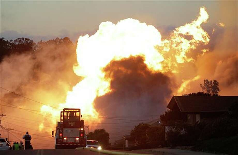 File - In this Sept. 9, 2010 file photo, a massive fire roars through a mostly residential neighborhood in San Bruno, Calif. PG&E is aggressively fighting what could be the costliest fallout yet from the deadly pipeline blast in San Bruno -- a lawsuit payout to explosion survivors that could reach billions of dollars. Photo: Paul Sakuma, AP / AP2010